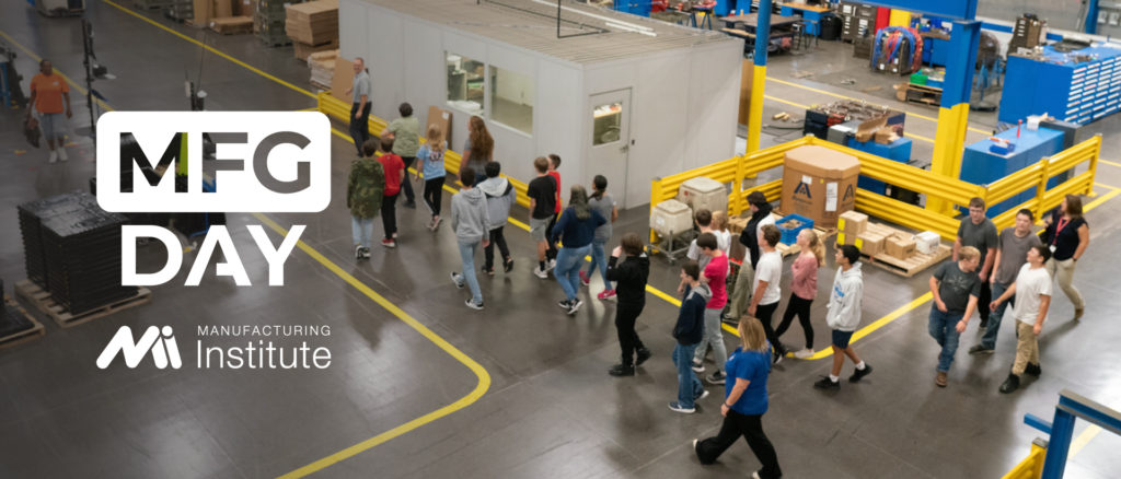 Students walk through a manufacturing facility during a MFG Day facility tour
